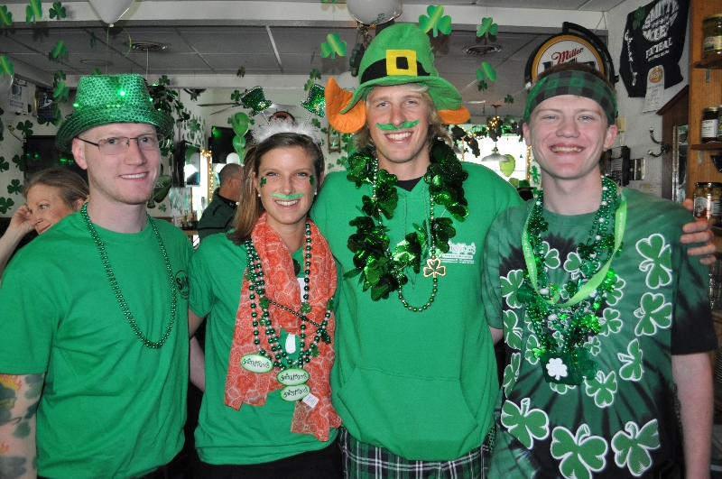 Group of friends wearing St. Patrick's Day attire