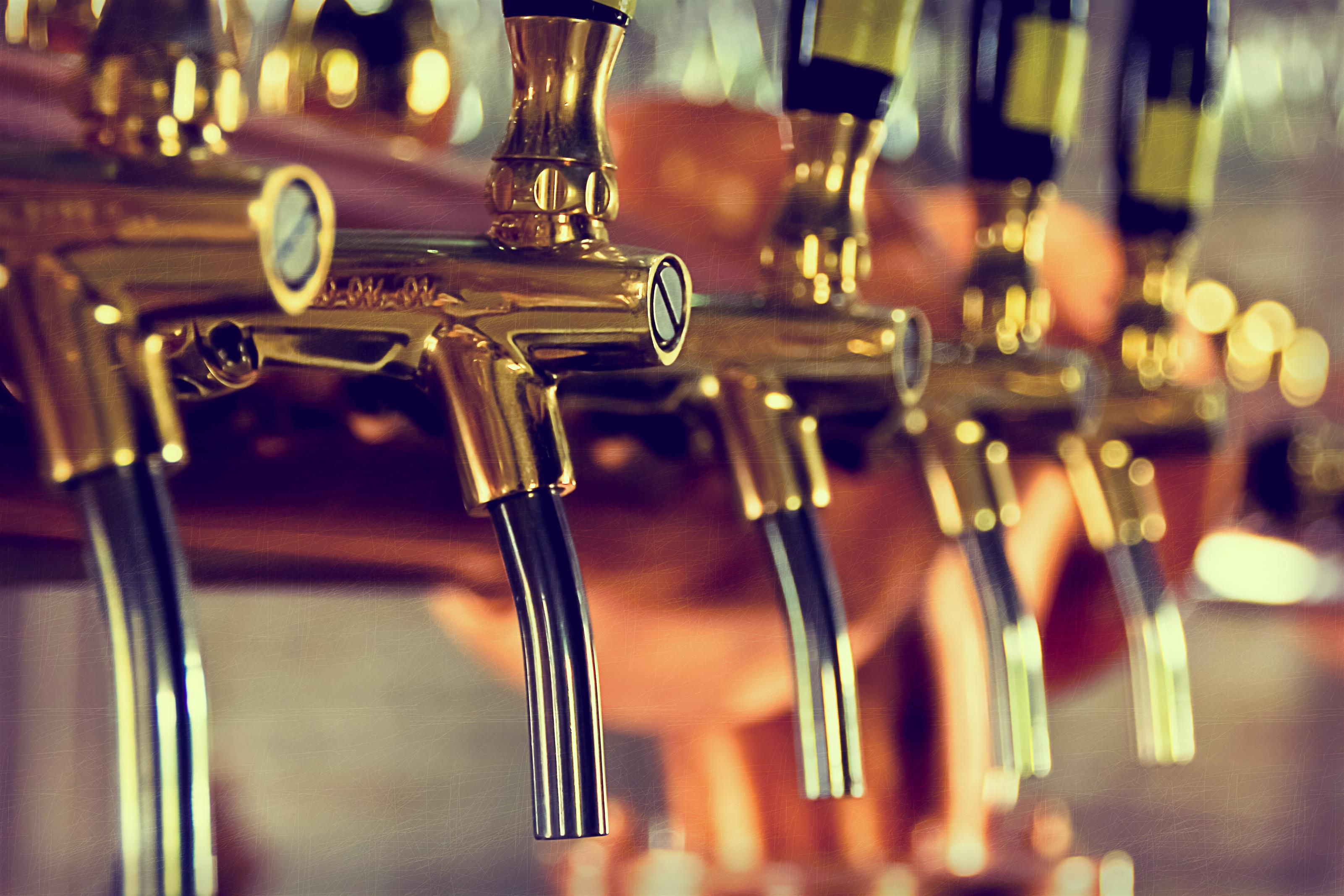 close up of brass beer taps