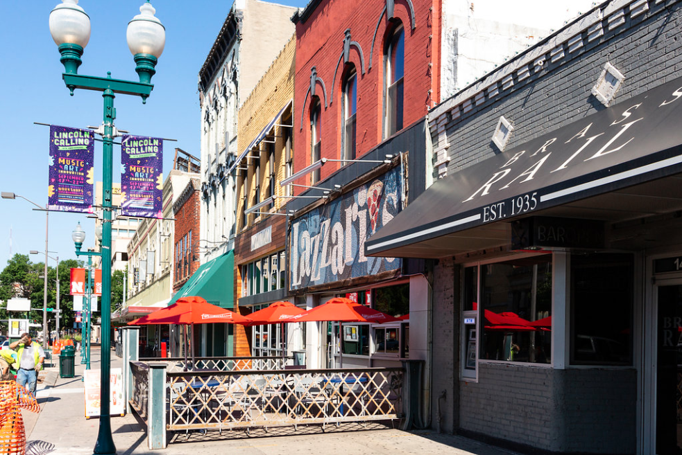 Exterior view of buildings and the patio area of Lazzari's Pizza