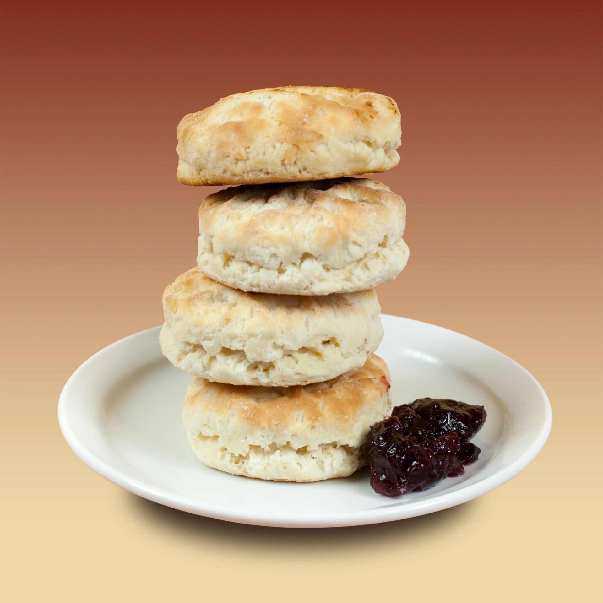 Biscuits stacked up on a plate