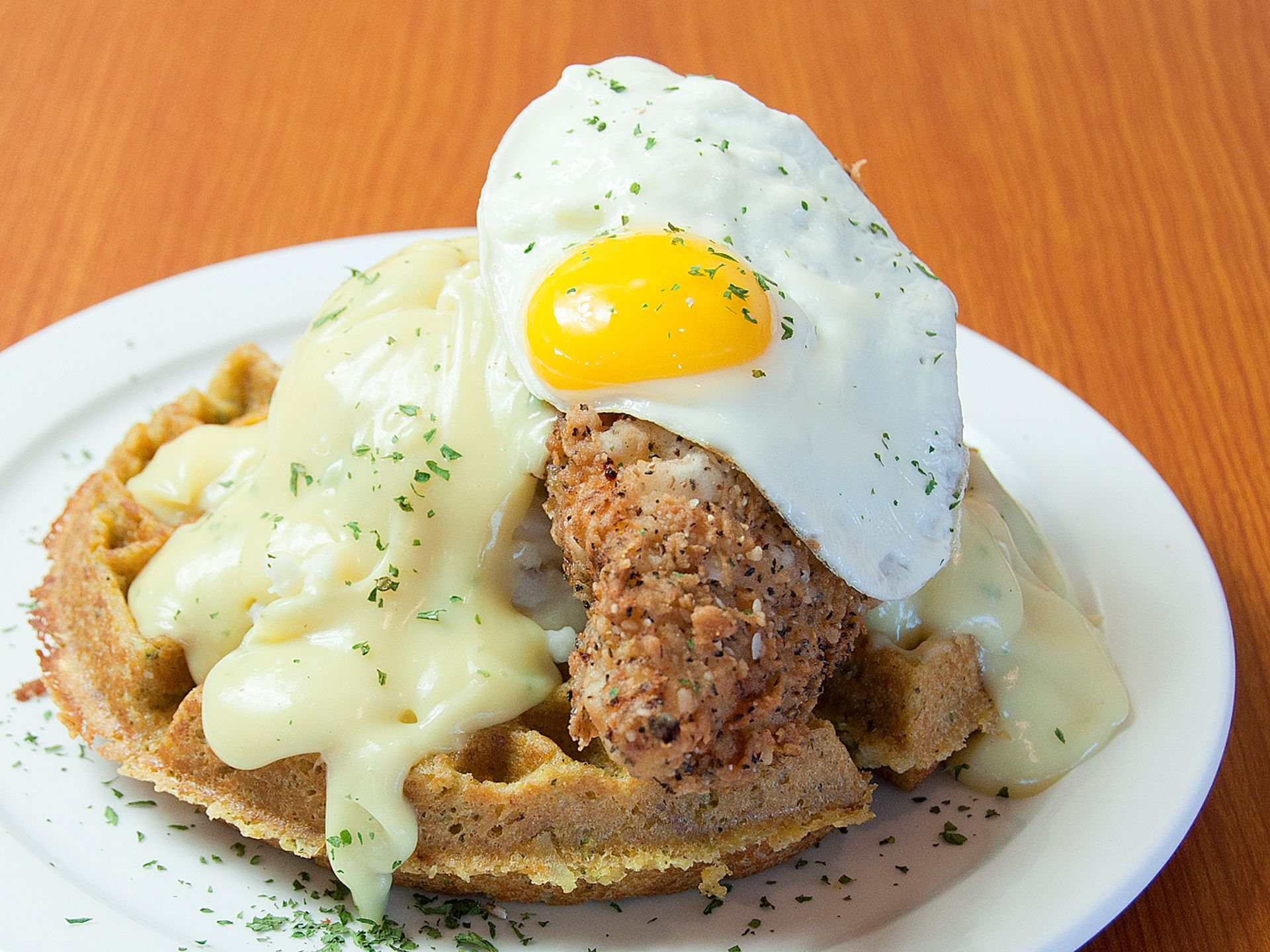 Chicken and waffles with a fried egg and gravy
