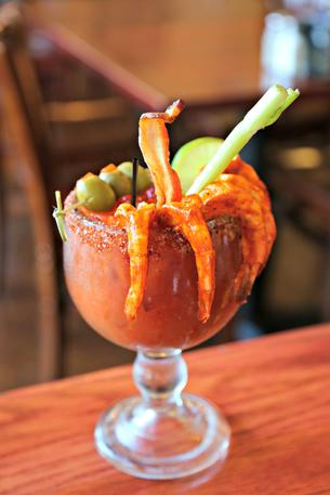 Ultimate Bloody Mary with green olives, celery, bacon and shrimp