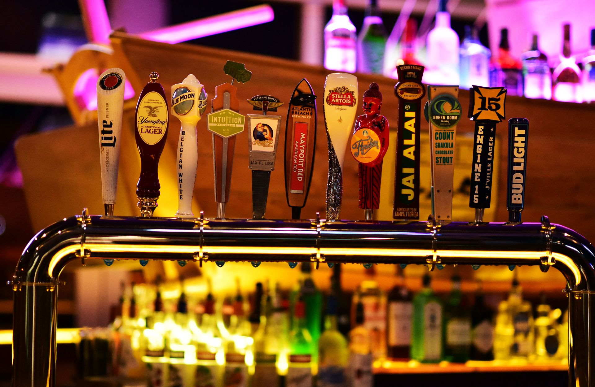 Assorted beer brands on beer tap handles
