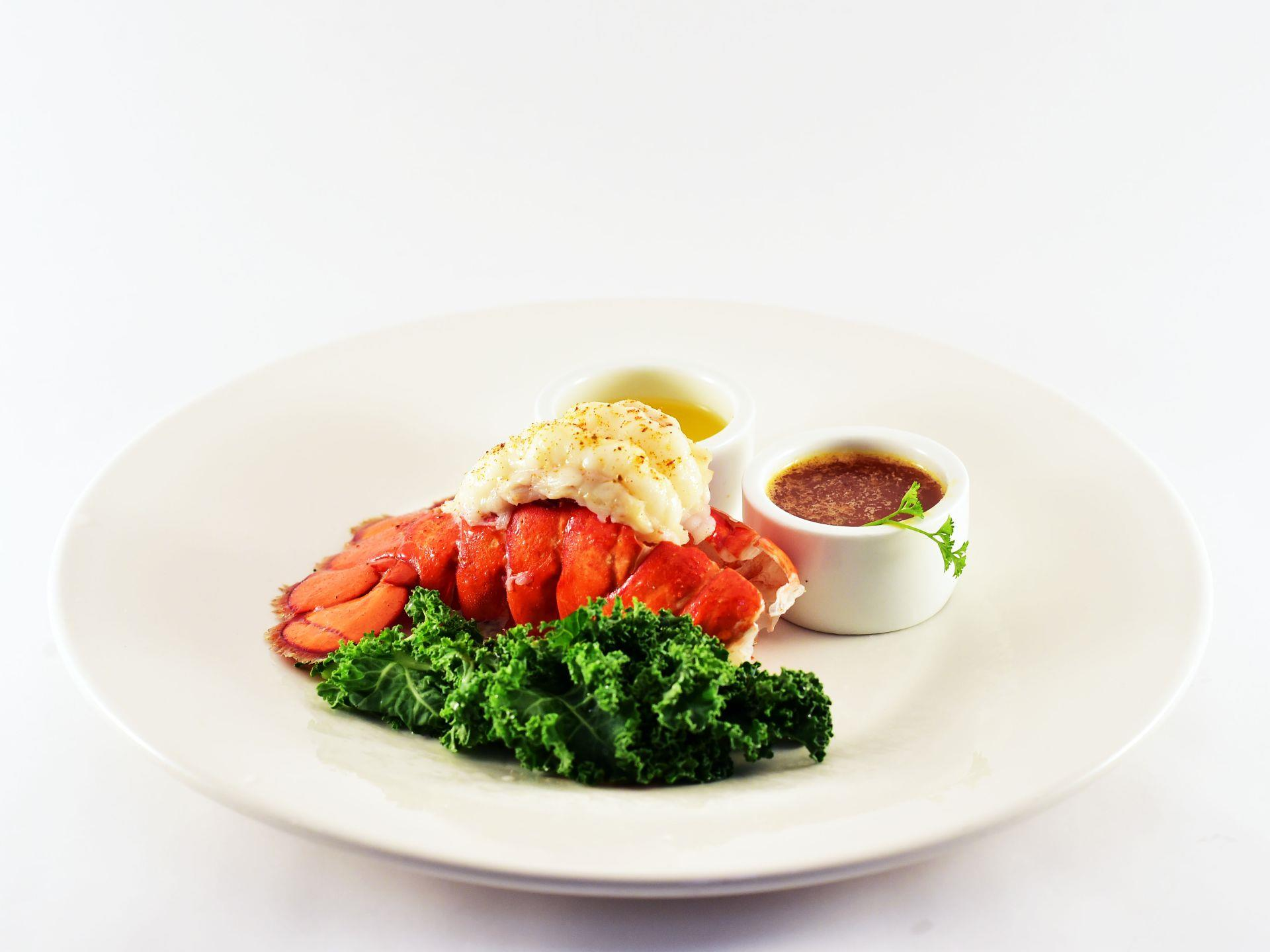 Steamed lobster tail with butter, coctail sauce and lettuce leaf