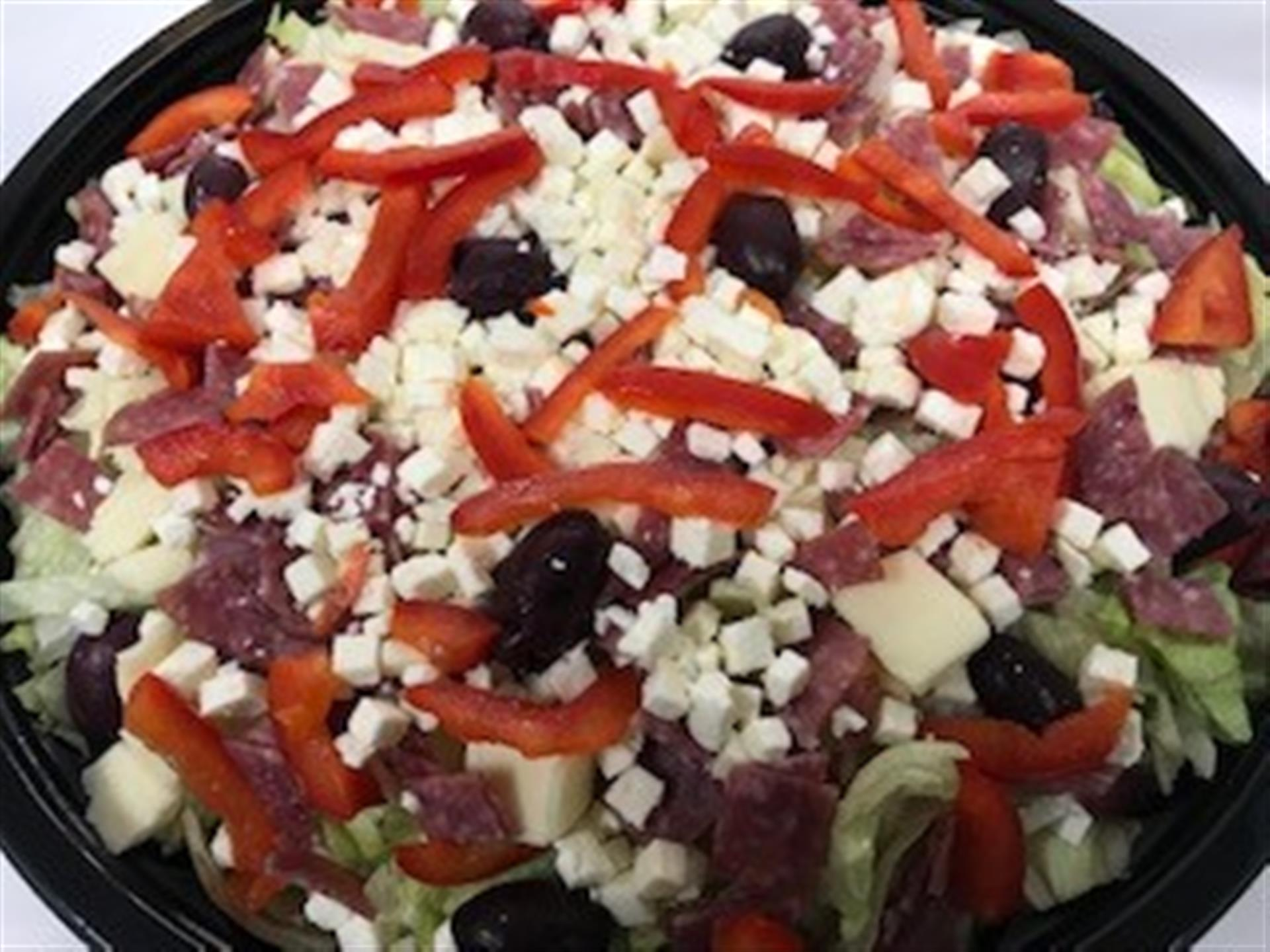 Antipasto Salad. Mozzarella, premium salami, kalamata olives, fresh red peppers and feta cheese over fresh crisp lettuce