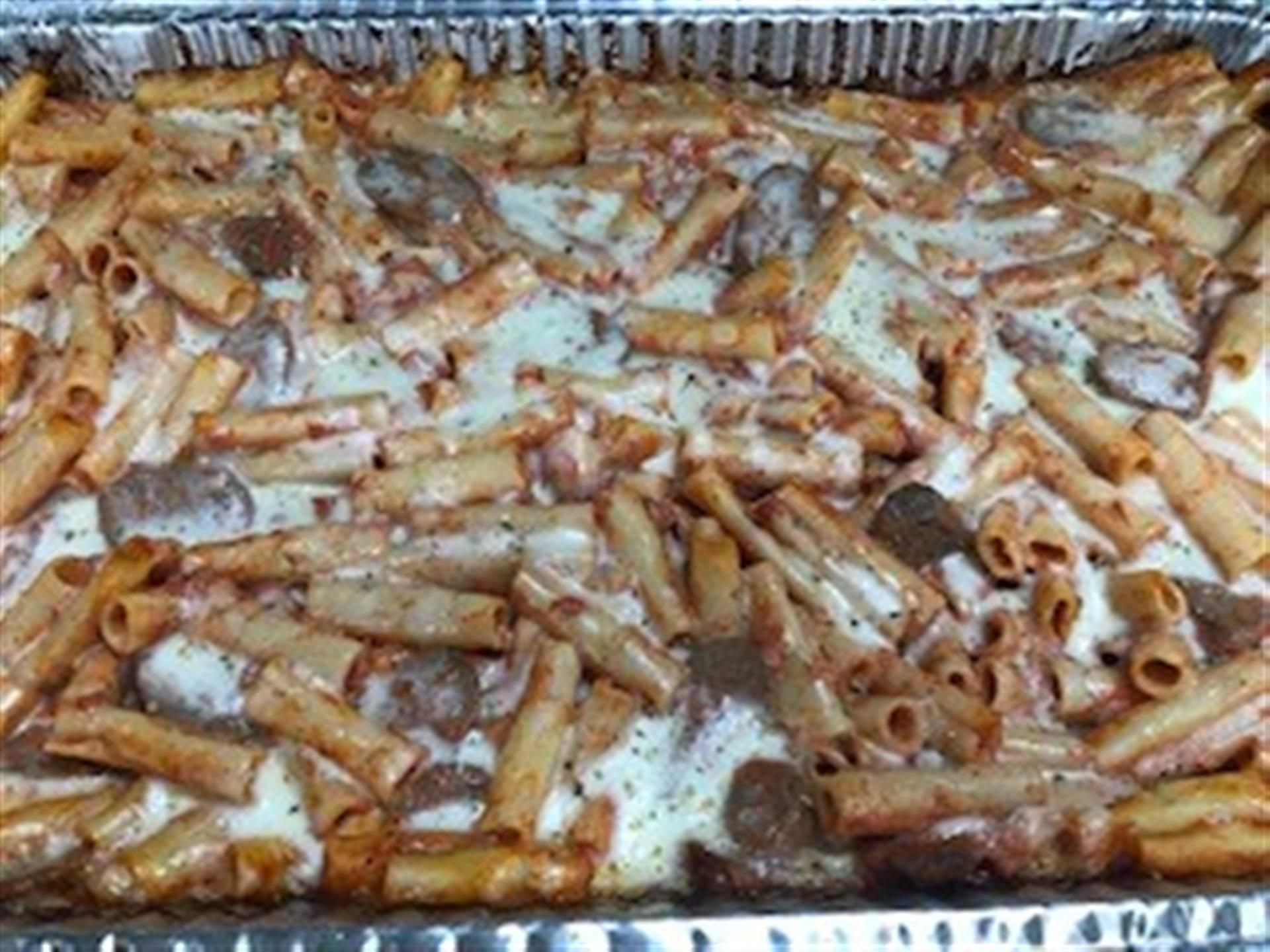 Tray of Baked Ziti with Italian Sausage. Homemade Italian sausage, homemade marinara, ricotta, mozzarella, provolone and imported house-grated Romano cheese, herbs and spices
