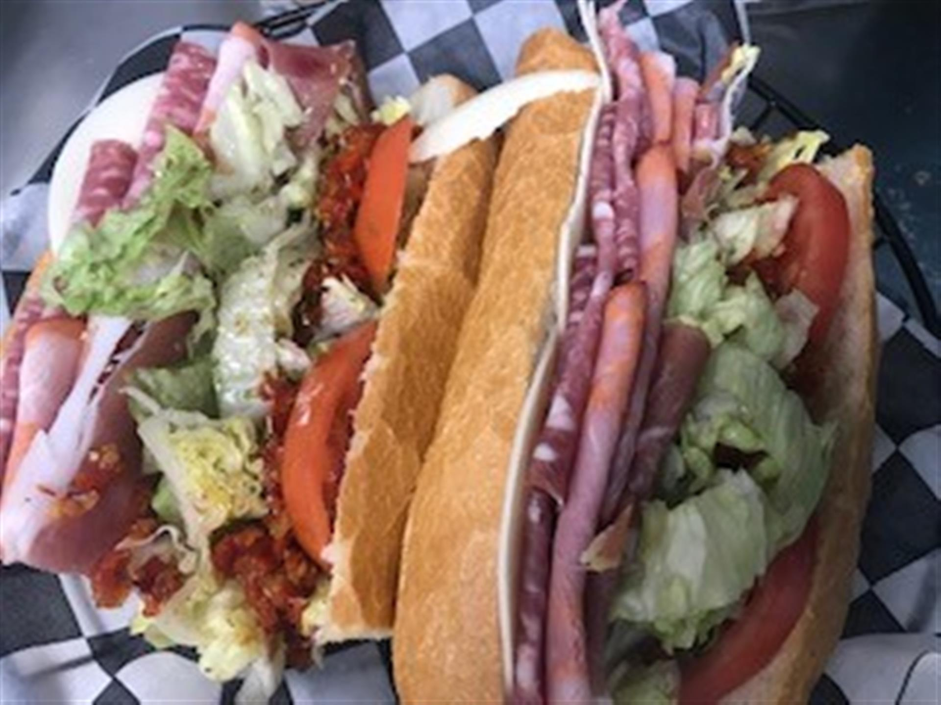 Two Italian Cold Cut subs on a plate