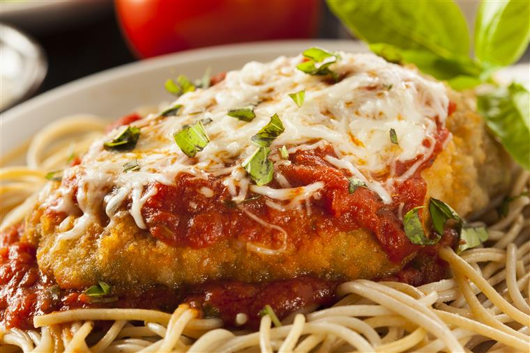 Chicken Parmesan. Breaded white-meat chicken cooked to perfection, covered in our signature homemade marinara sauce, imported house-grated Romano cheese, melted mozzarella over a bed of fresh-cooked spaghetti pasta and side of garlic bread