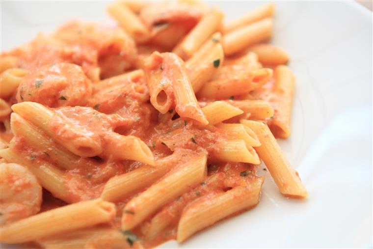 penne pasta in vodka sauce on a white plate