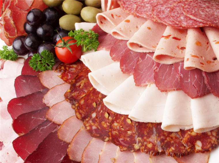 assorted cured meats and olives