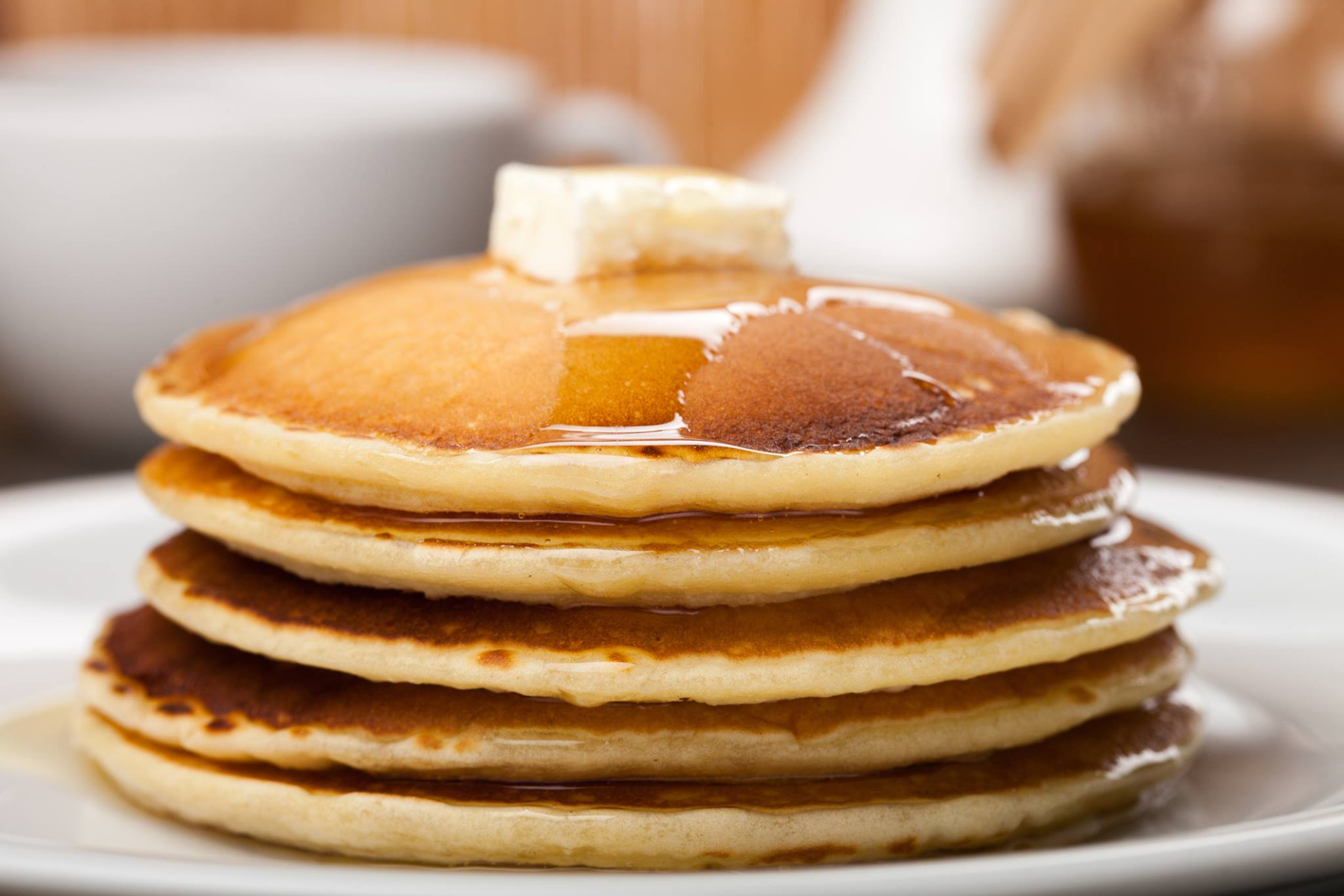 Stack of pancakes with maple syrup and butter