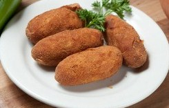 4 croquetas on a white plate