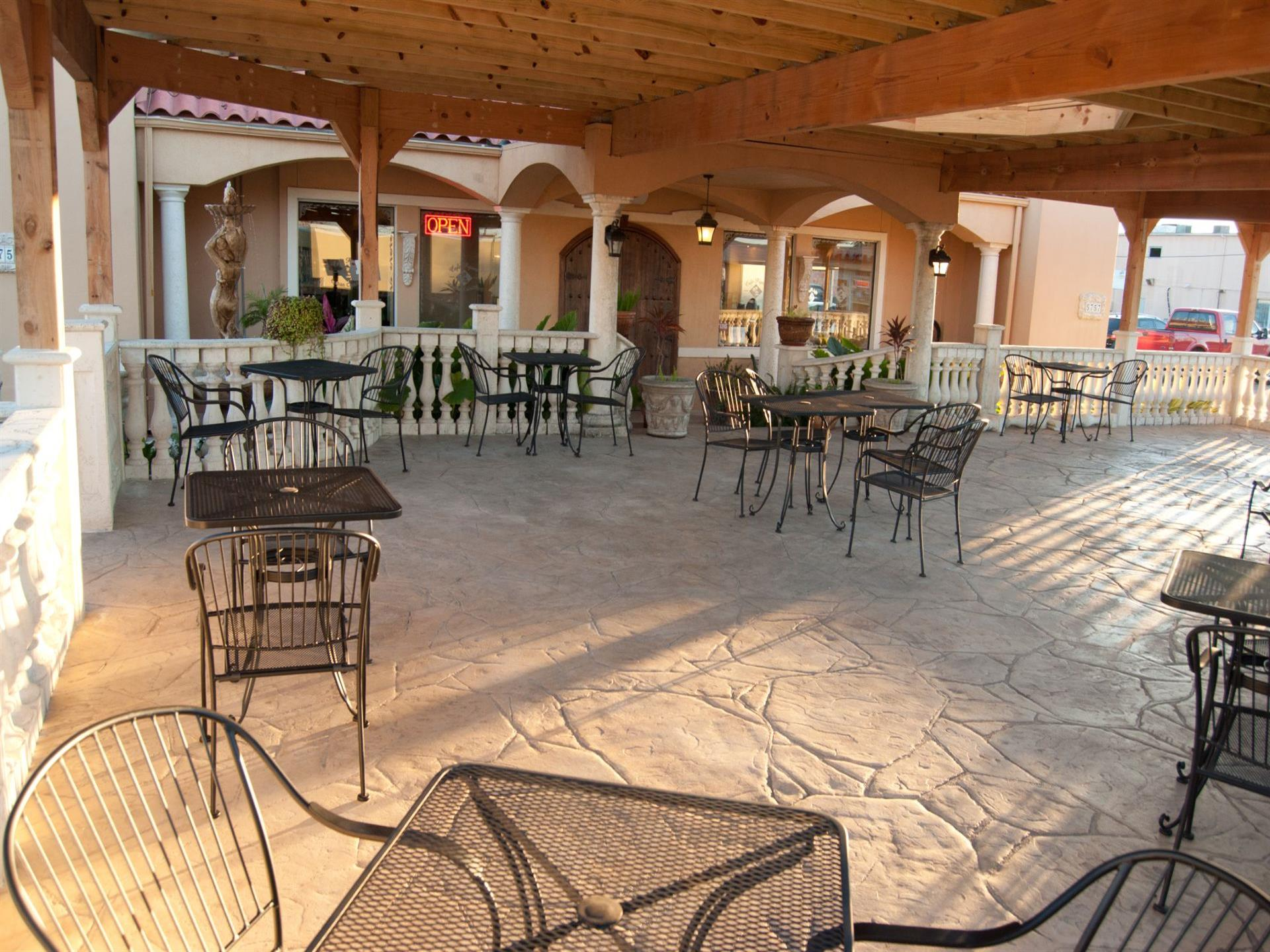 Outdoor patio. Black metal tables and chairs.