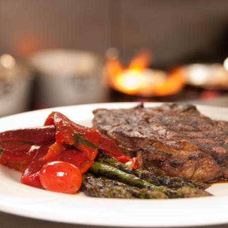 Grilled steak with roasted red peppers and asparagus