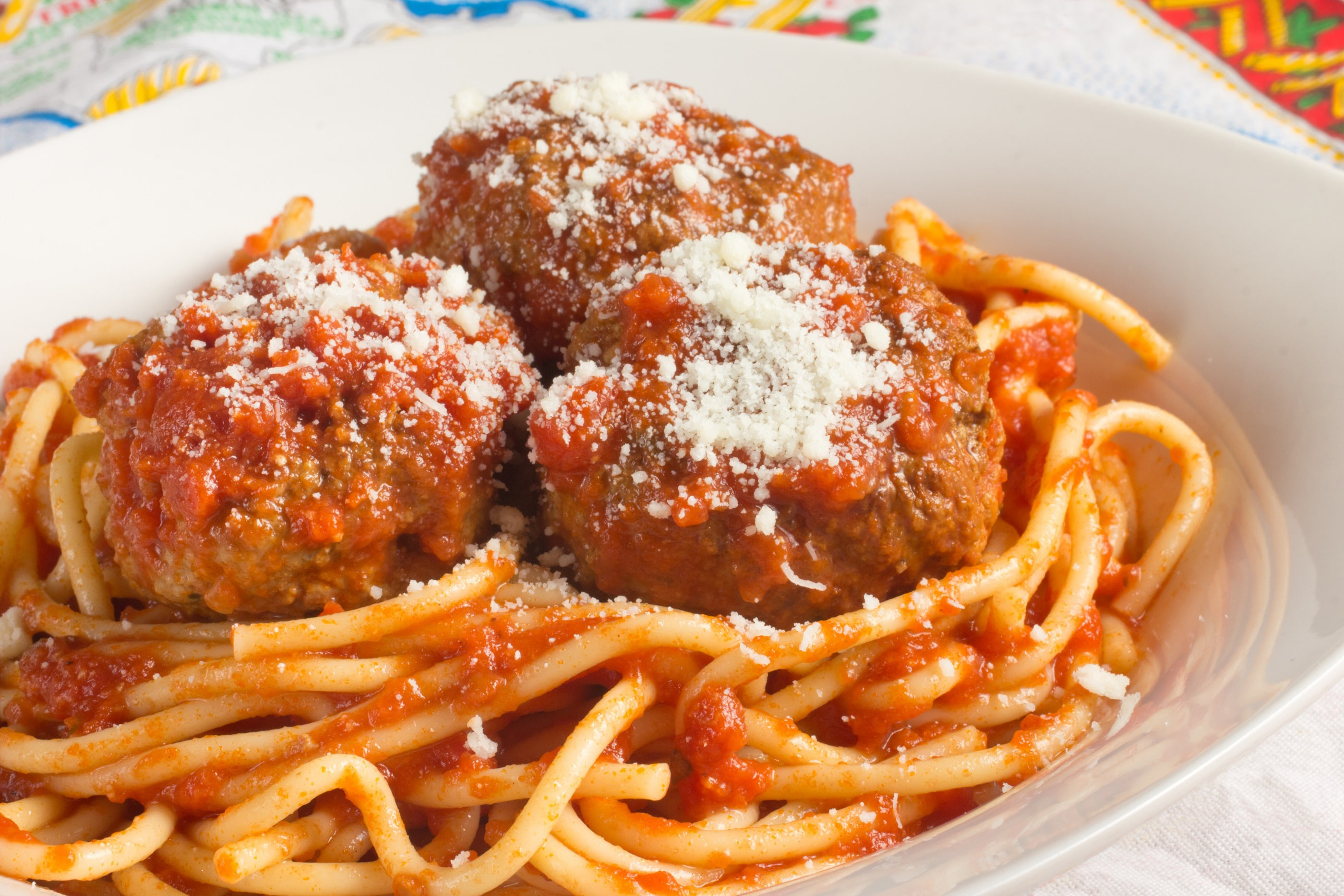 Spaghetti and meatballs in a white bowl