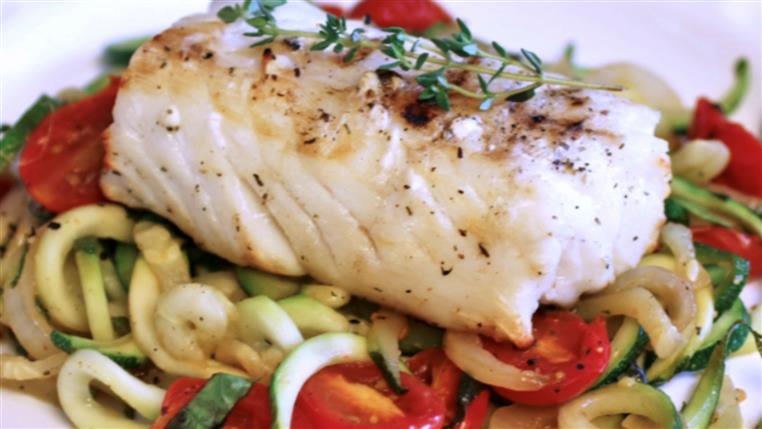 Oven baked Chilean sea bass filet over zucchini noodles