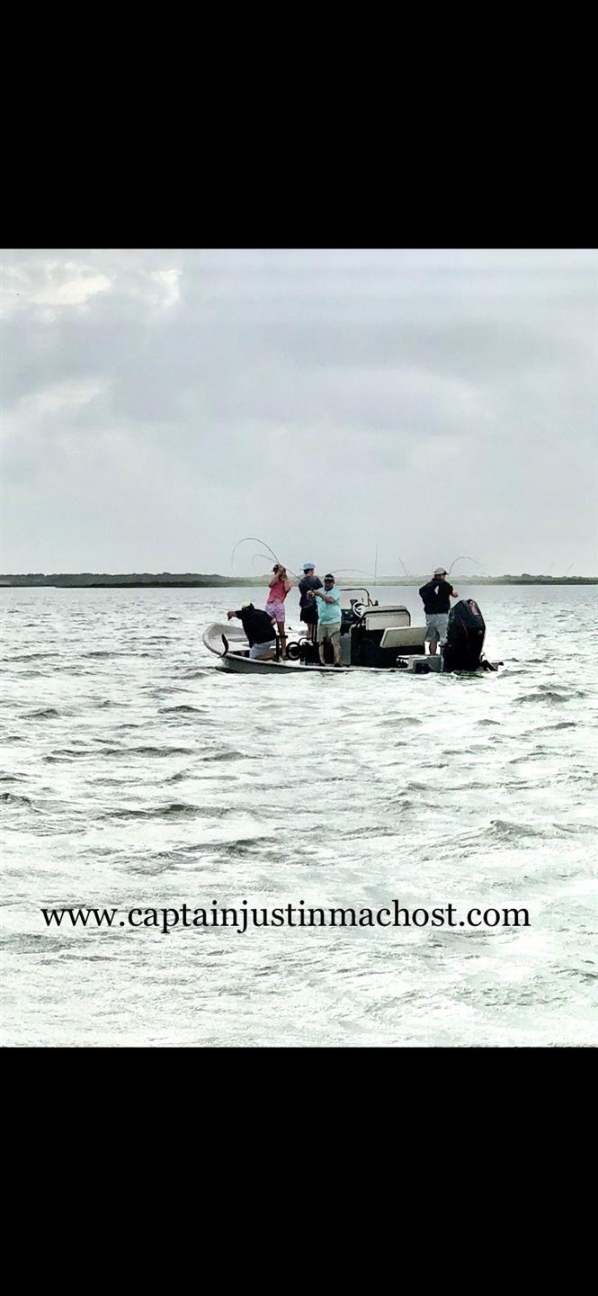 Boat in the water with 3 people fishing