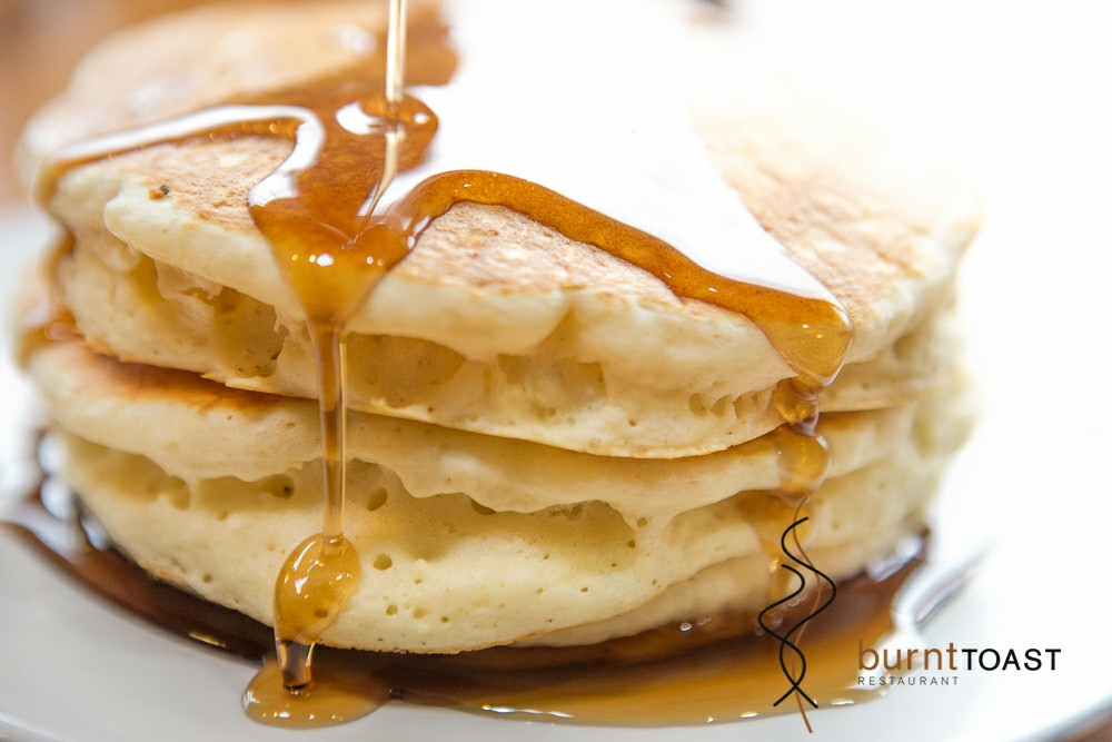 Stack of pancakes with maple syrup drizzled on top