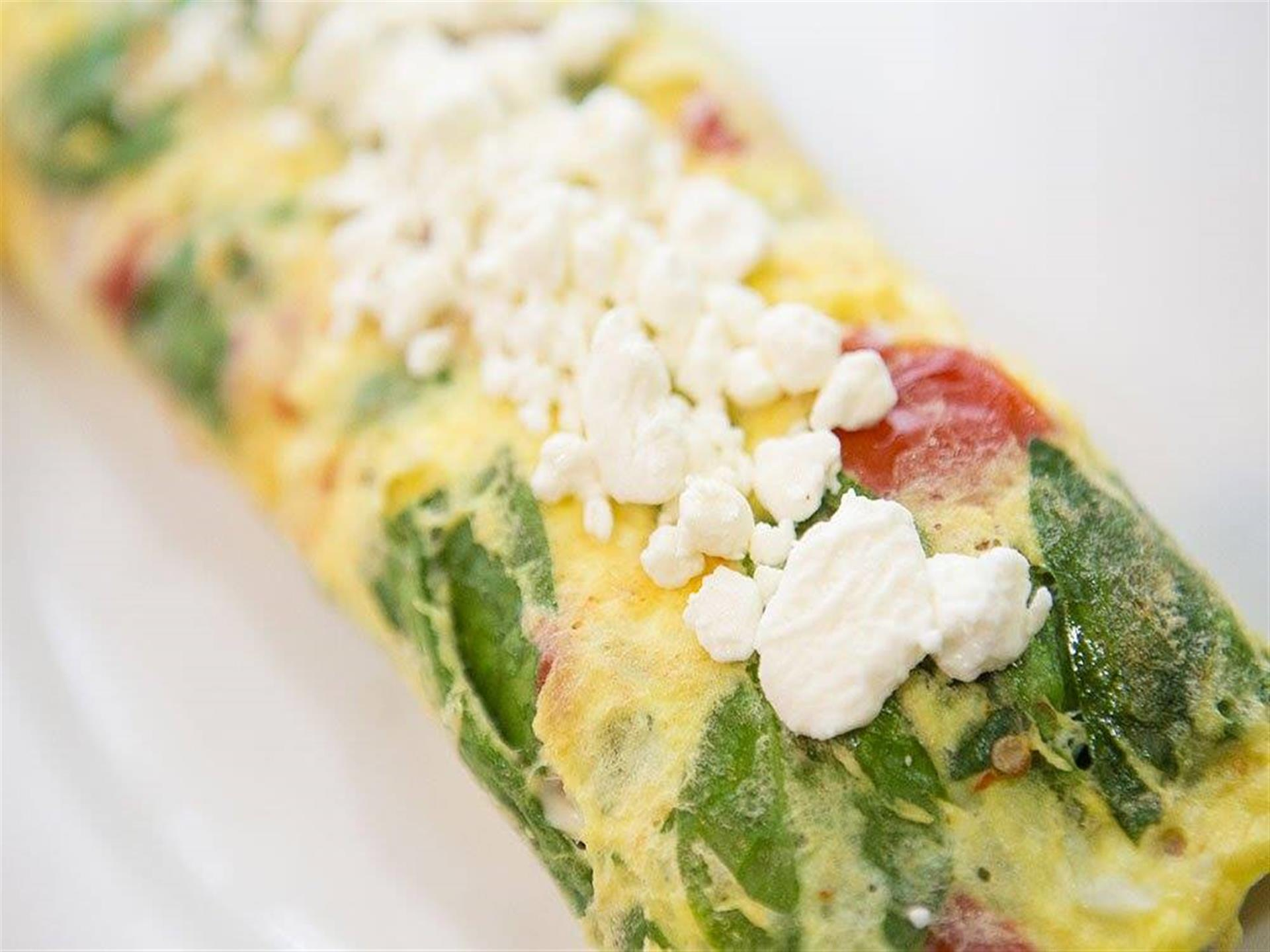 Spinach and tomato omelet with feta cheese