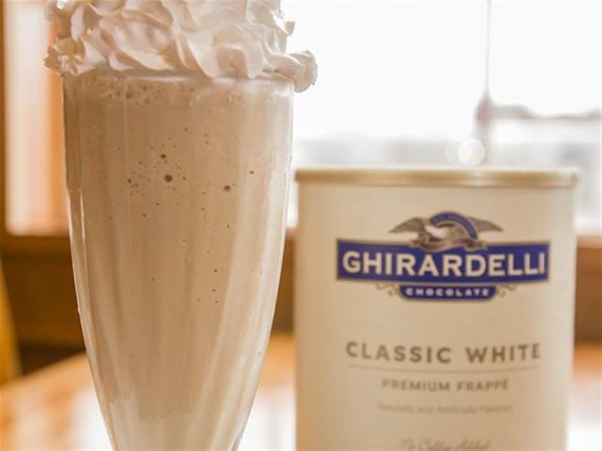 Vanilla shake made with Ghirardelli Classic White ice cream and topped with whipped cream