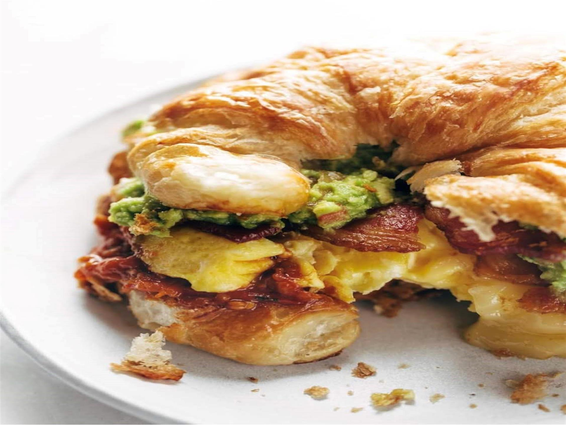 Baja Breakfast Croissant. All you really need in life is love & a good croissant! Scrambled eggs, thick bacon, our homemade garlic butter tomato sauce & our flavorful guacamole. Served with hash browns.
