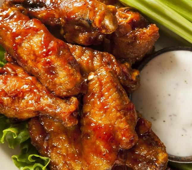Buffalo chicken wings with celery sticks and bleu cheese
