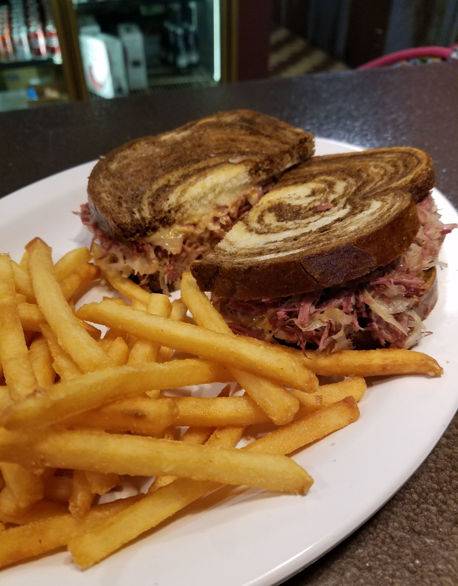 Reuben sandwich on marble rye with French fries