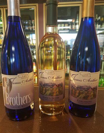 three bottles of james arthur wine