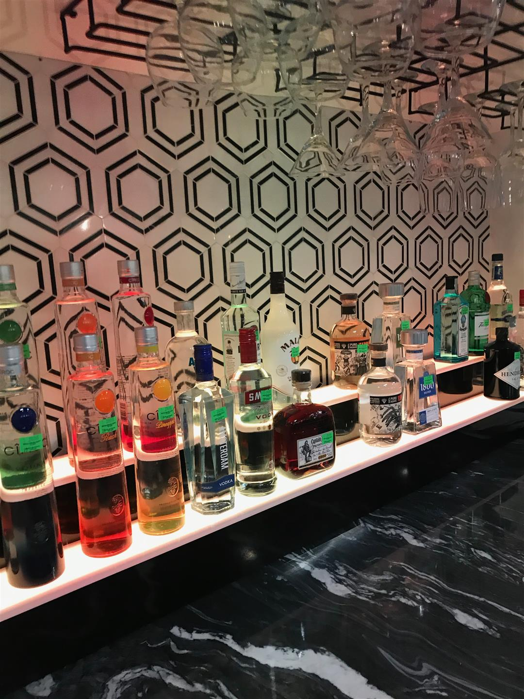 bar area with various liquors