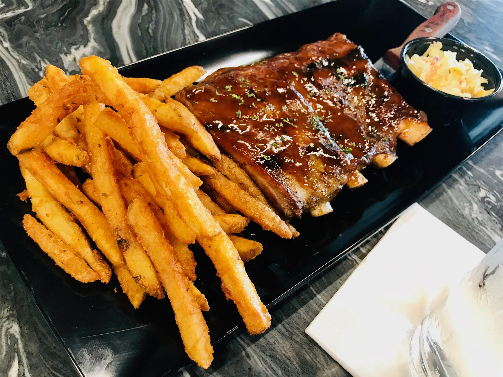 Mike's Honey Chipotle Ribs with a side of french fries