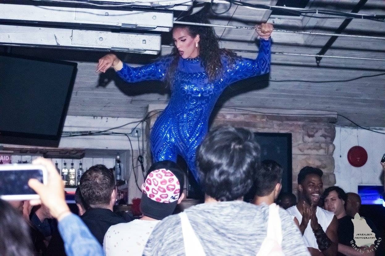 Performer on stage dancing in front of guests