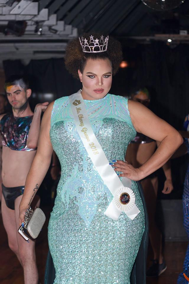 Miss Fire Island Pageant contestant wearing a tiara and a light blue dress posing for a photo