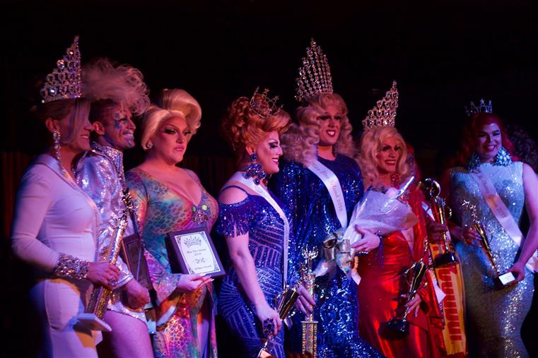 eight pageant contestants on stage after being crowned