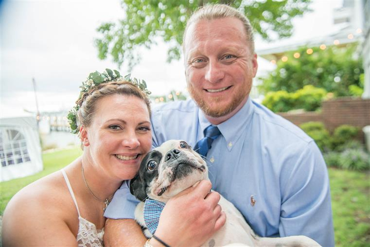 Regan, the Innkeeper, with her husband, Casey, and their Boston Terrier, Murphy.
