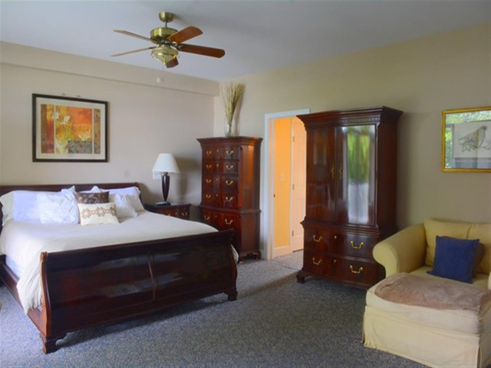 Suite one. Dark wood furniture and a king-size bed