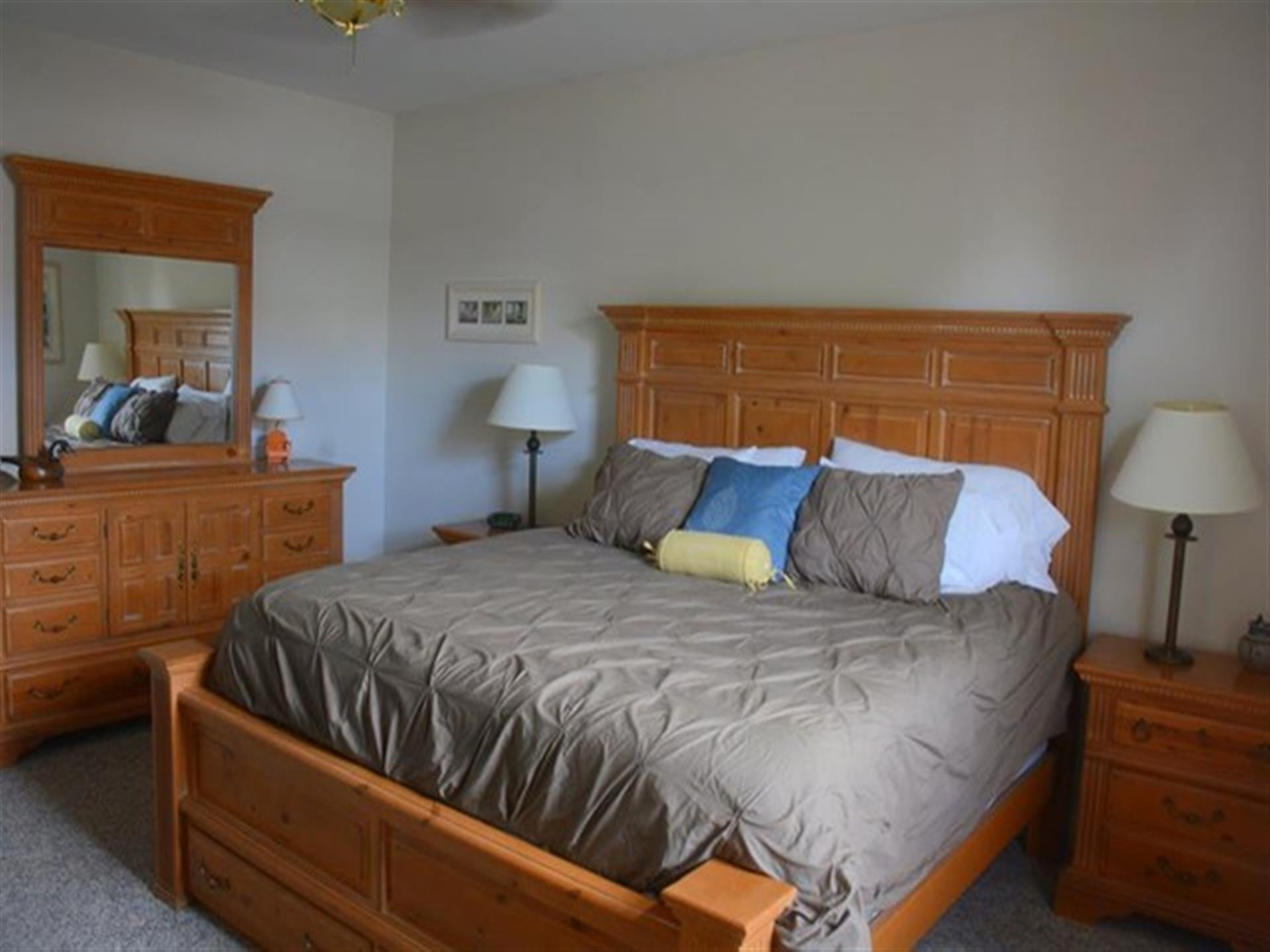 Suite 2. Light wood furniture and a king-size bed.