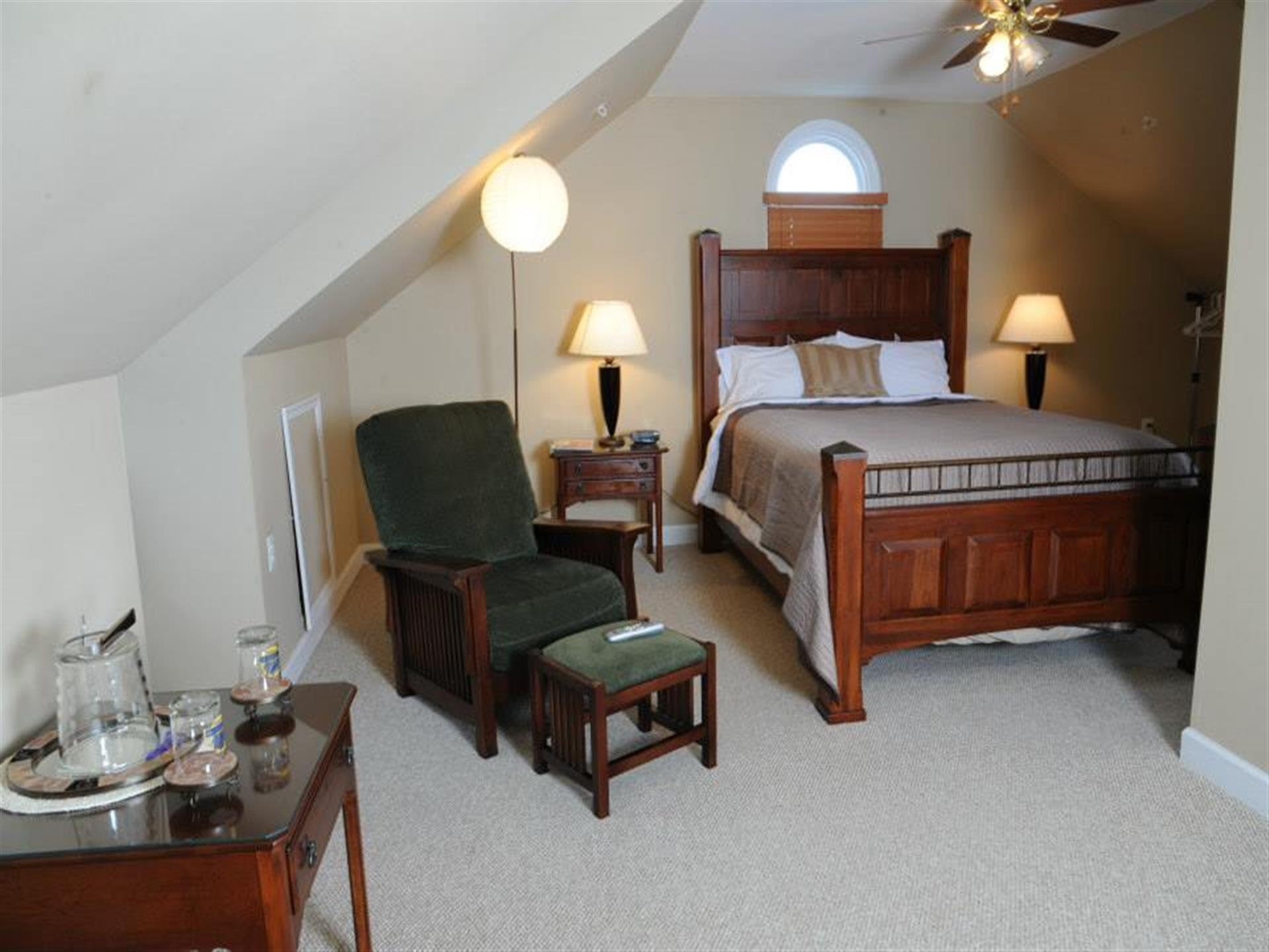 Suite 3 bedroom. Queen size bed and dark wood furniture.