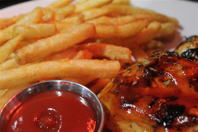 BBQ Chicken plate. Two of our original, juicy chicken breasts topped with barbecue sauce. french fries on the side with ketchup.