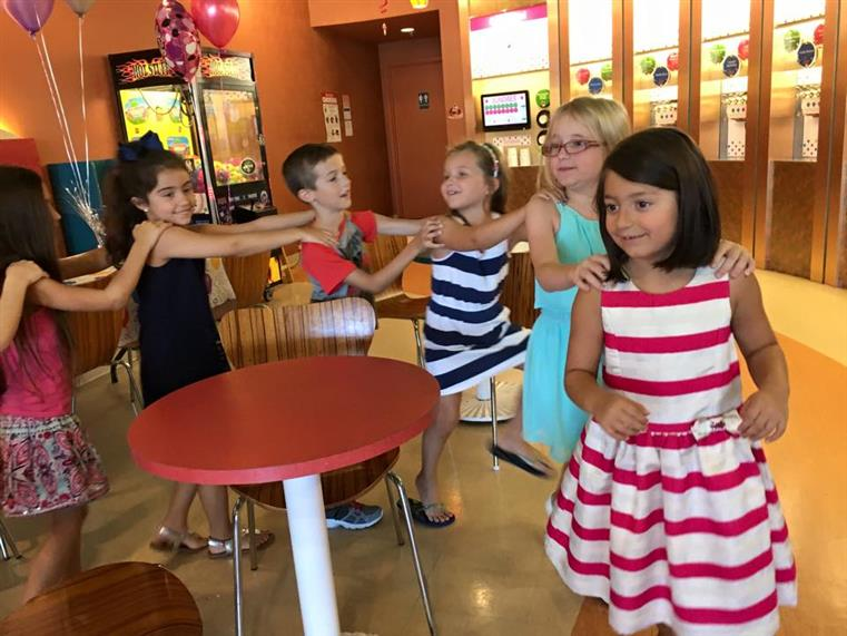 kids dancing at a sundaes birthday party