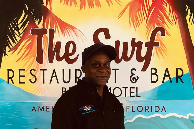 Headshot of Ernie in front of The Surf sign - Kitchen Manager