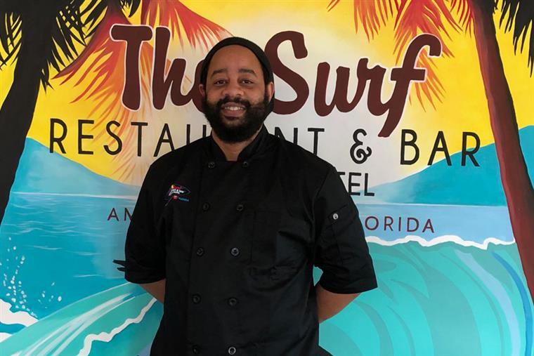 Headshot of JB in front of The Surf sign - Chef & grill master