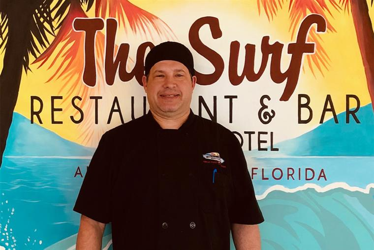 Headshot of Steve in front of The Surf sign - Food & Beverage Director