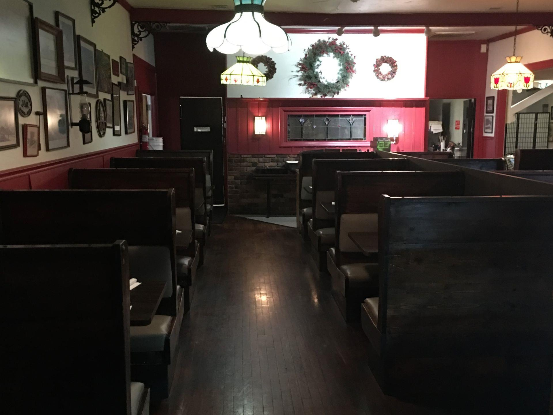Interior dining area with booths and pictures hanging on the walls