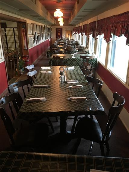One of the dining cars at Clarksville Station. Vintage feel with White and red walls, old paintings on the wall of the trains.