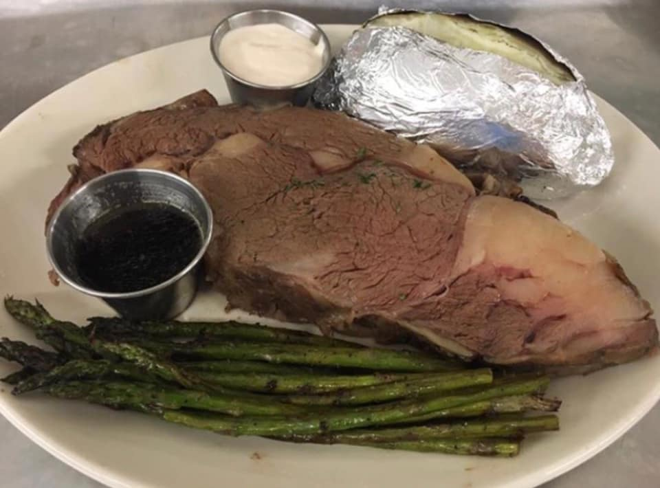 Juicy Prime Rib with au jus, horseradish sauce, asparagus and a baked potato.
