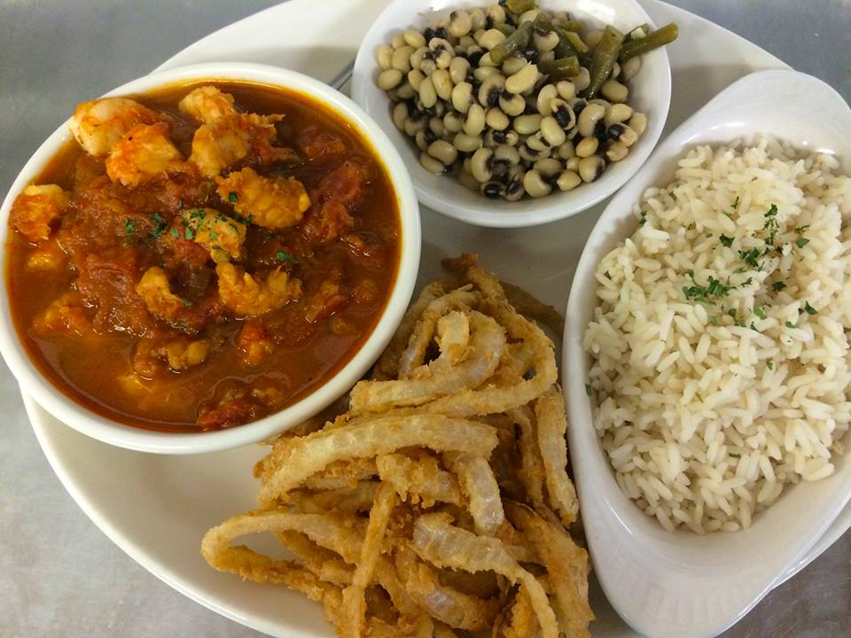 Savory Shrimp Creole over rice with our Famous Onion Rings