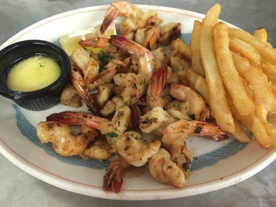 Succulent local Grilled Fantail Shrimp with French fries on the side.