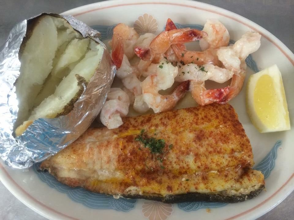 Broiled Flounder, Fantail Shrimp and a baked potato on the side.