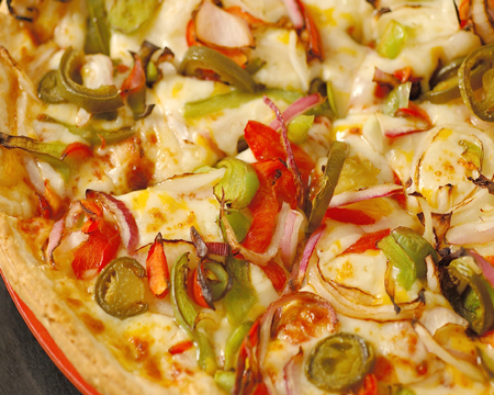 pizza with cheese, peppers and onions