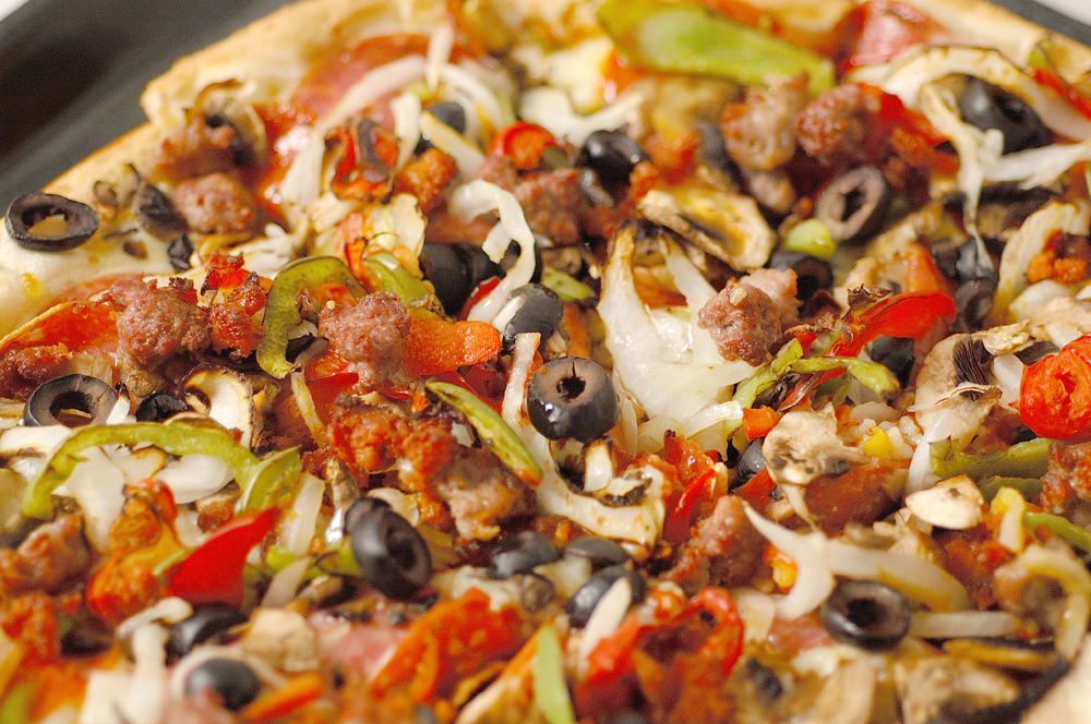 combo pizza with sausage, pepperoni, peppers, onions and olives